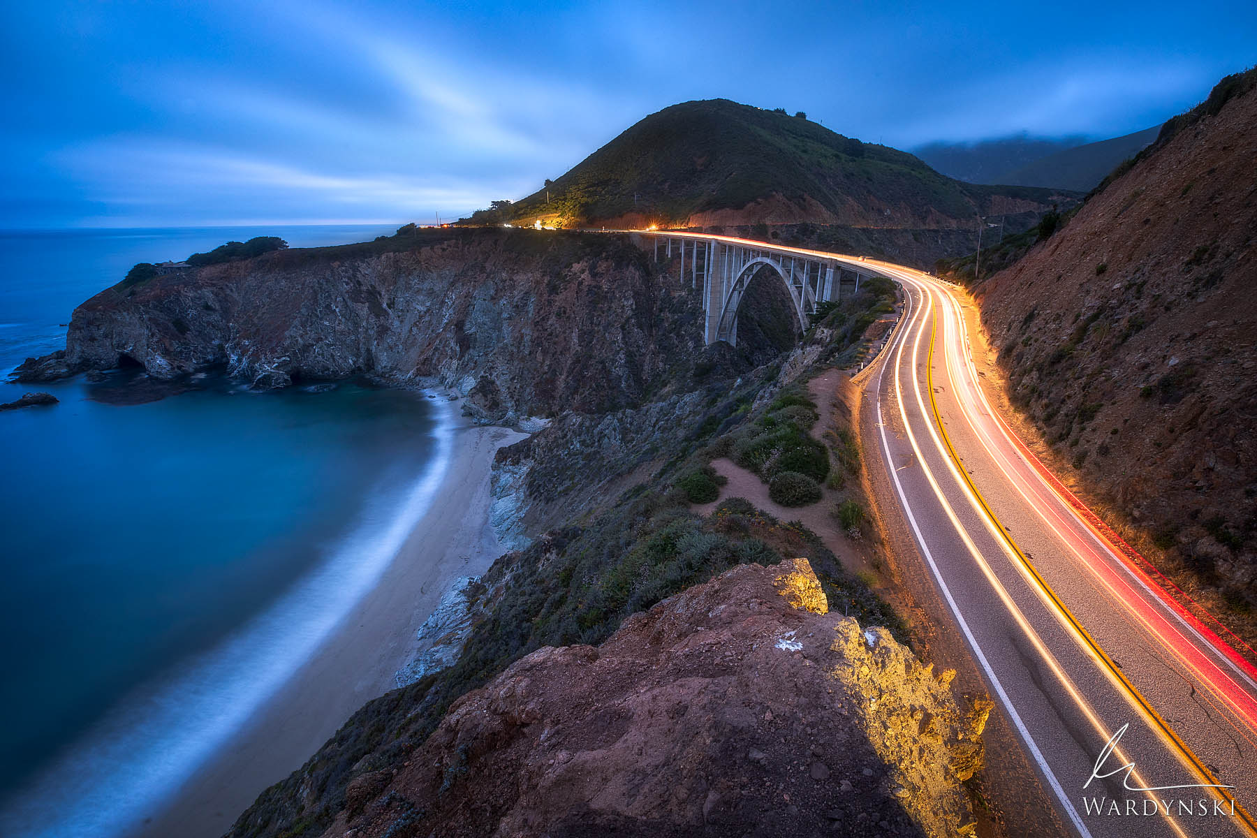 Fine Art Print | Limited Edition of 100  Car lights streak across Bixby Bridge shortly before the night sky takes hold in Big...
