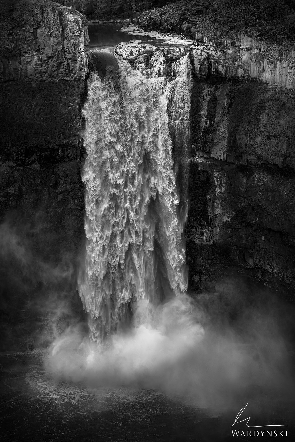 Black and White Fine Art Print | Limited Edition of 50 Water gushes over the brink of Palouse Falls in Eastern Washington. The...