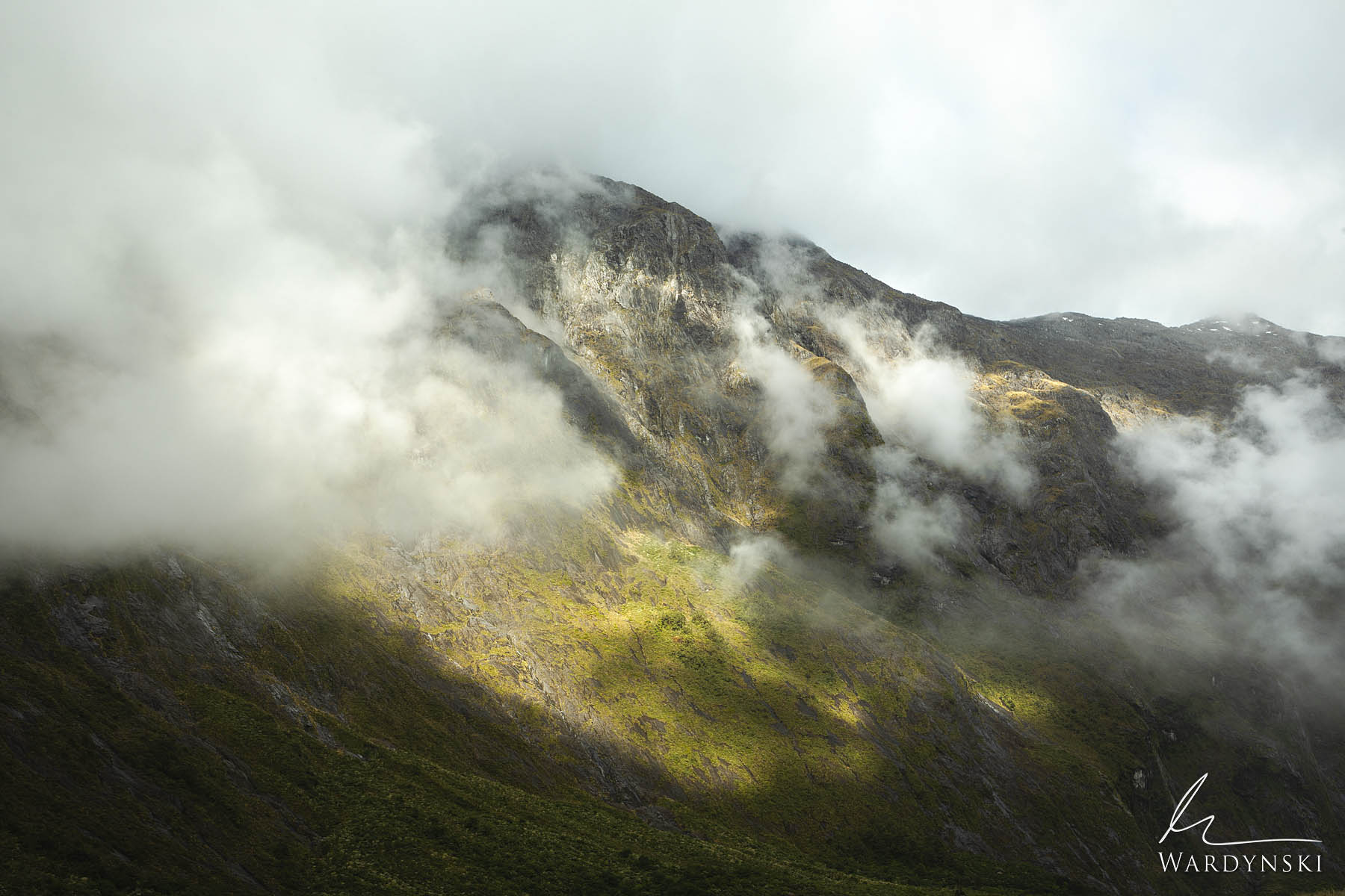 Fine Art Print | Limited Edition of 100  Clouds dance around the mountains of Fiordland National Park as a clearing storm makes...