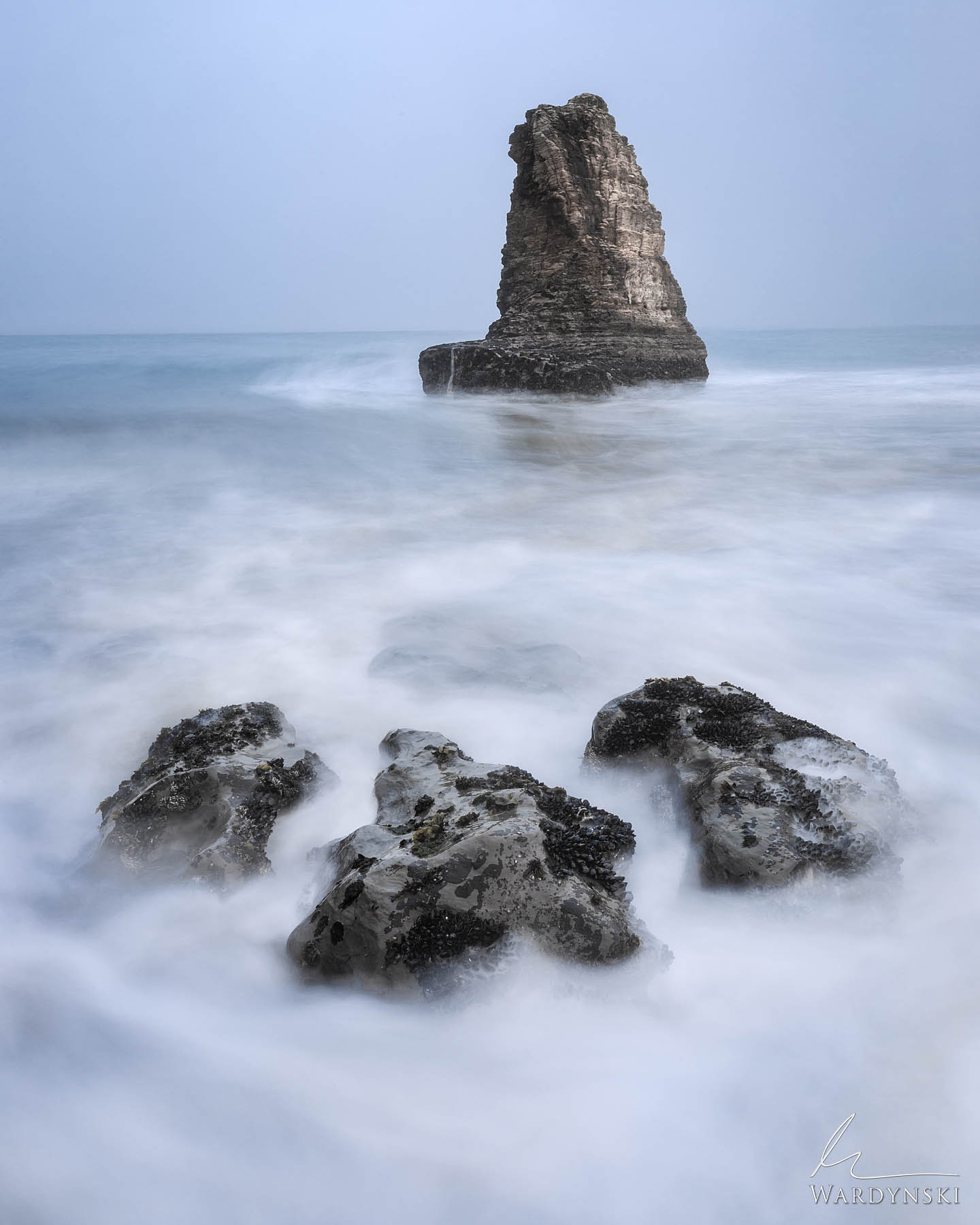 Fine Art Print | Limited Edition of 25  Fragmented rocks rise from the surf like pieces of a puzzle in Davenport California....