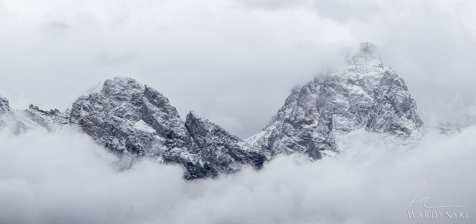 Fine Art Print | Limited Edition of 100 Granite peaks reach out of the clouds during a winter storm in Grand Teton National Park...