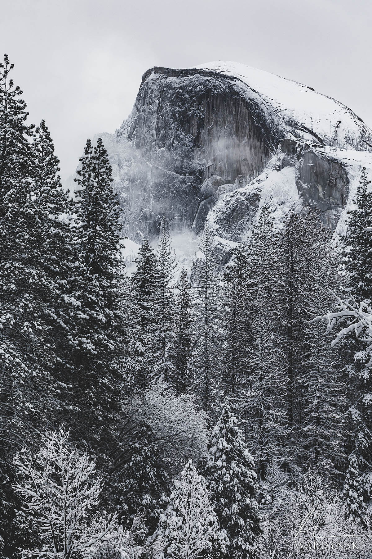 Fine Art Print | Limited Edition of 100  A frosty Halfdome emerges from a veil of clouds on a cold winter evening in Yosemite...