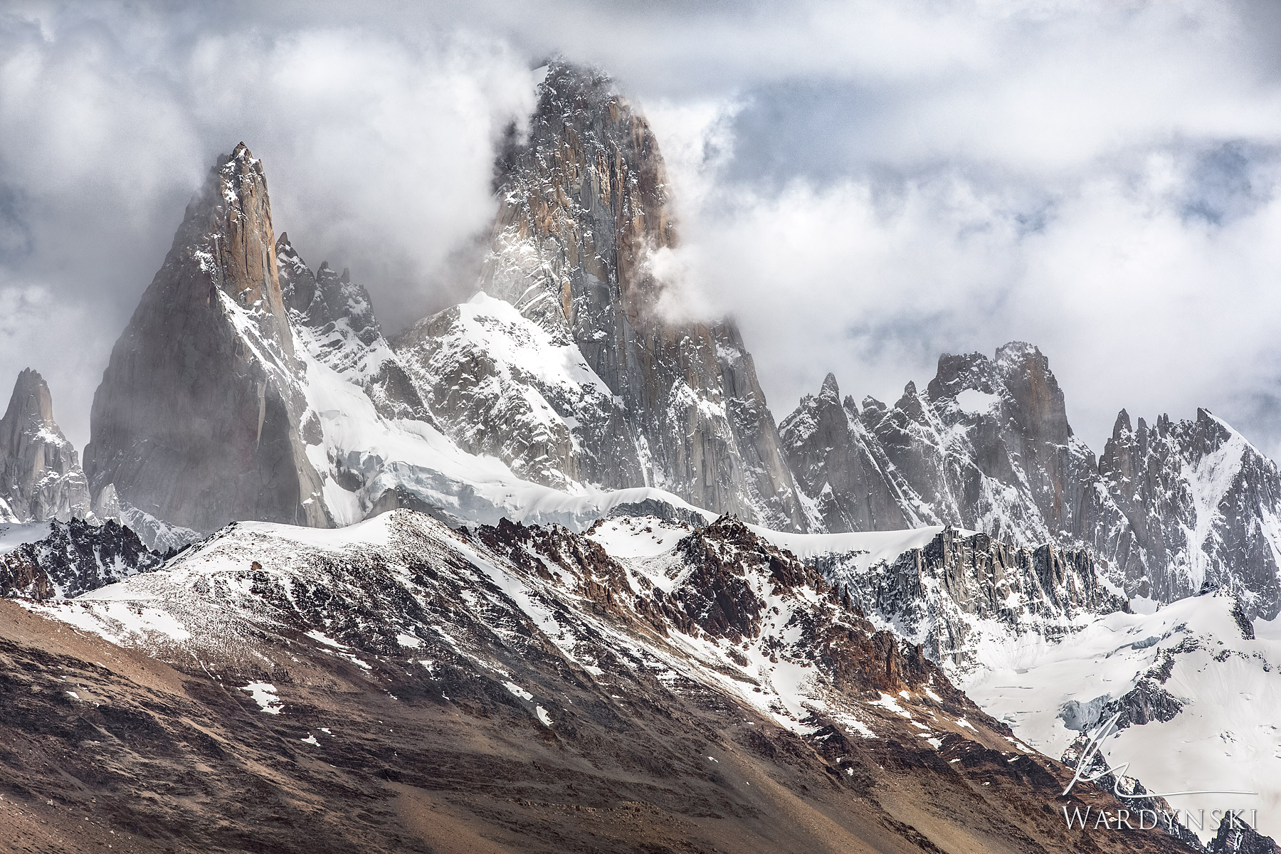 Fine Art Print | Limited Edition of 100   Mount Fitz Roy rises up into the clouds like an opulent castle covered in snow. This...