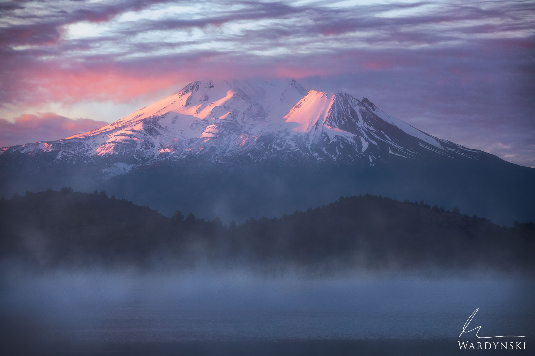 Fine Art Print | Limited Edition of 25  Pink light strikes Mount Shasta at sunrise as mist rises from a nearby lake. This massive...