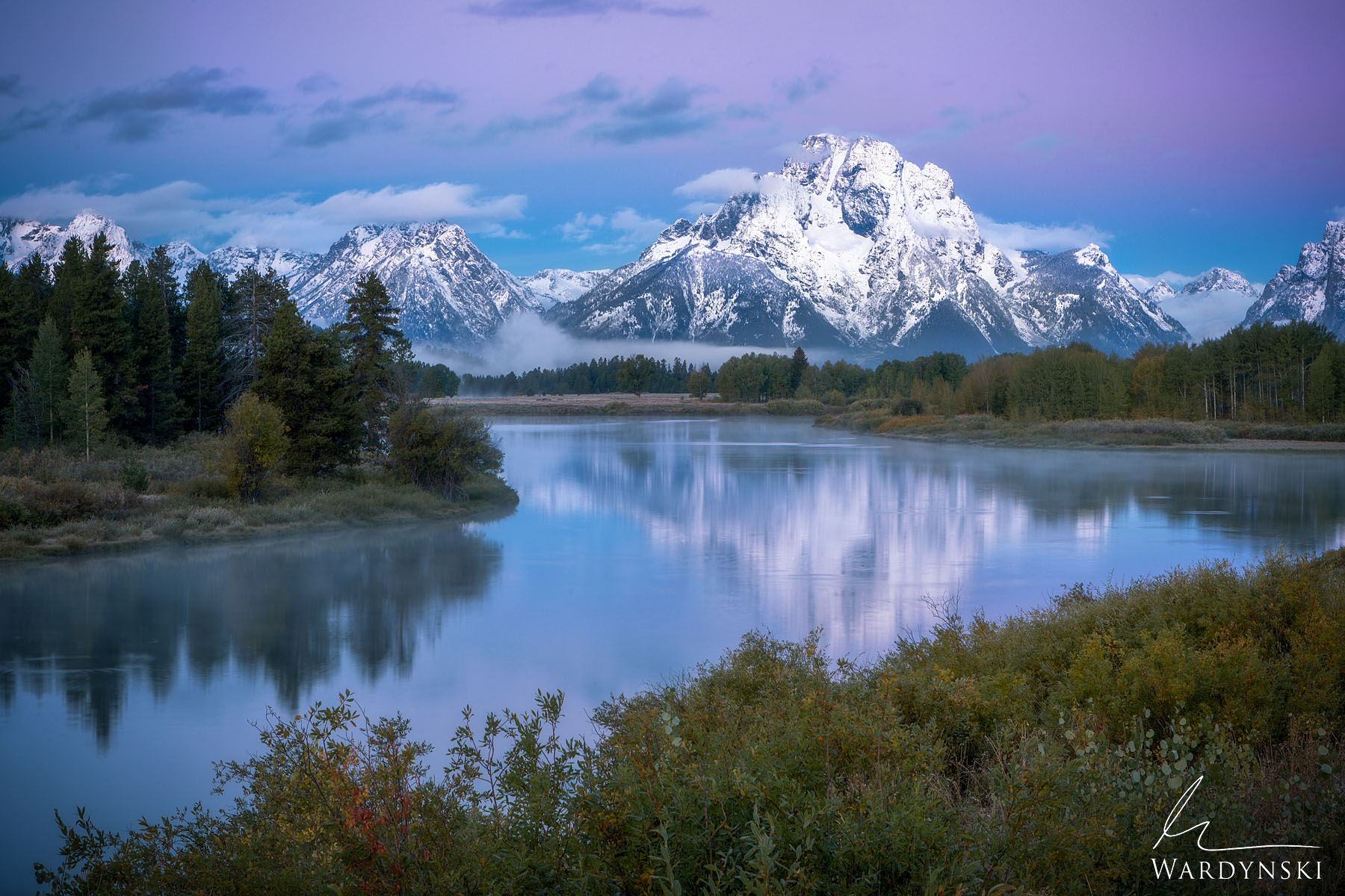 Fine Art Print | Limited Edition of 50  A brisk morning in Grand Teton Wyoming reveals a purple sunrise and a cloak of fog at...