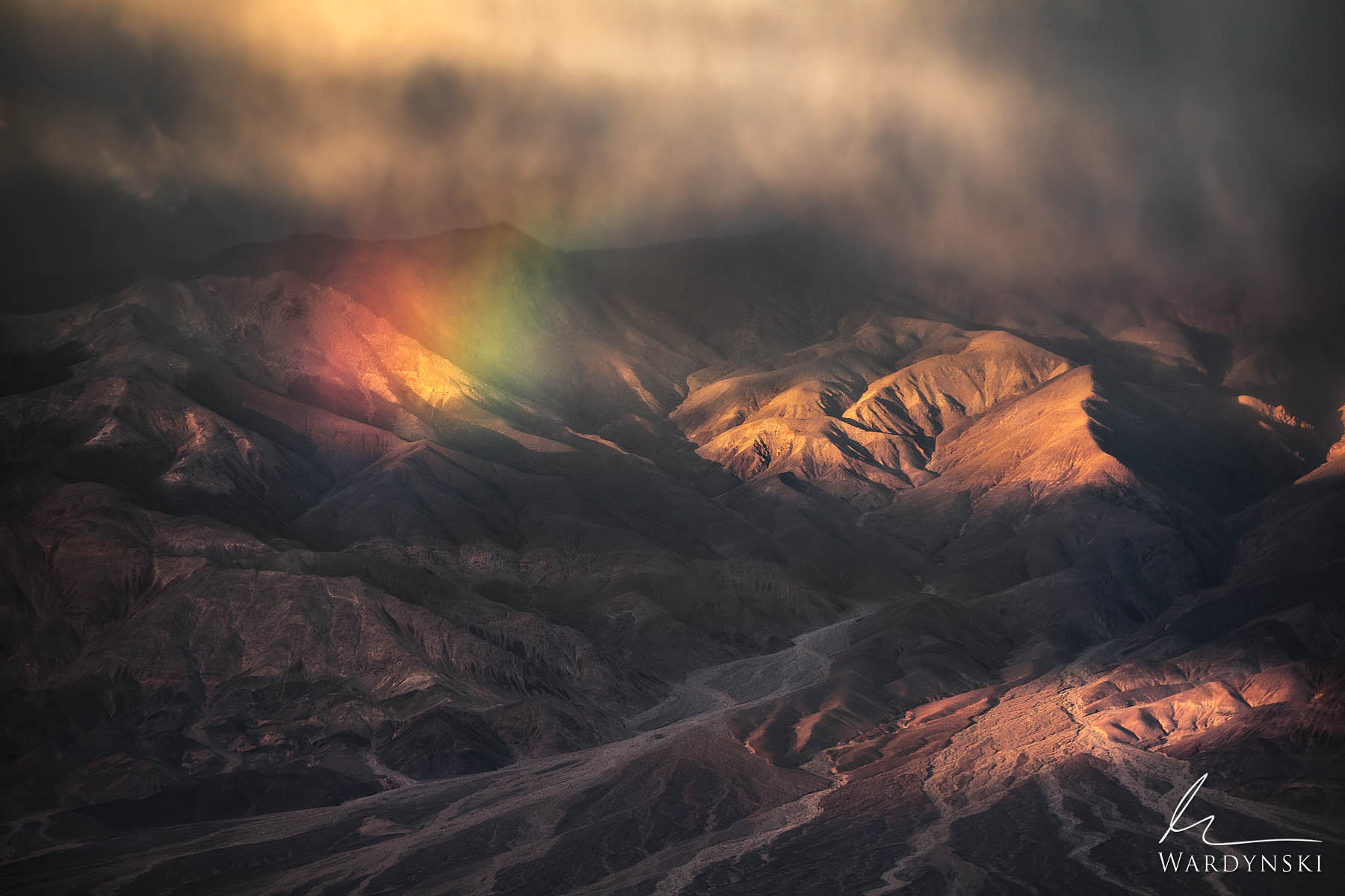 Fine Art Print | Limited Edition of 25  A vibrant rainbow appears over Death Valley on a cold and windy February morning. This...