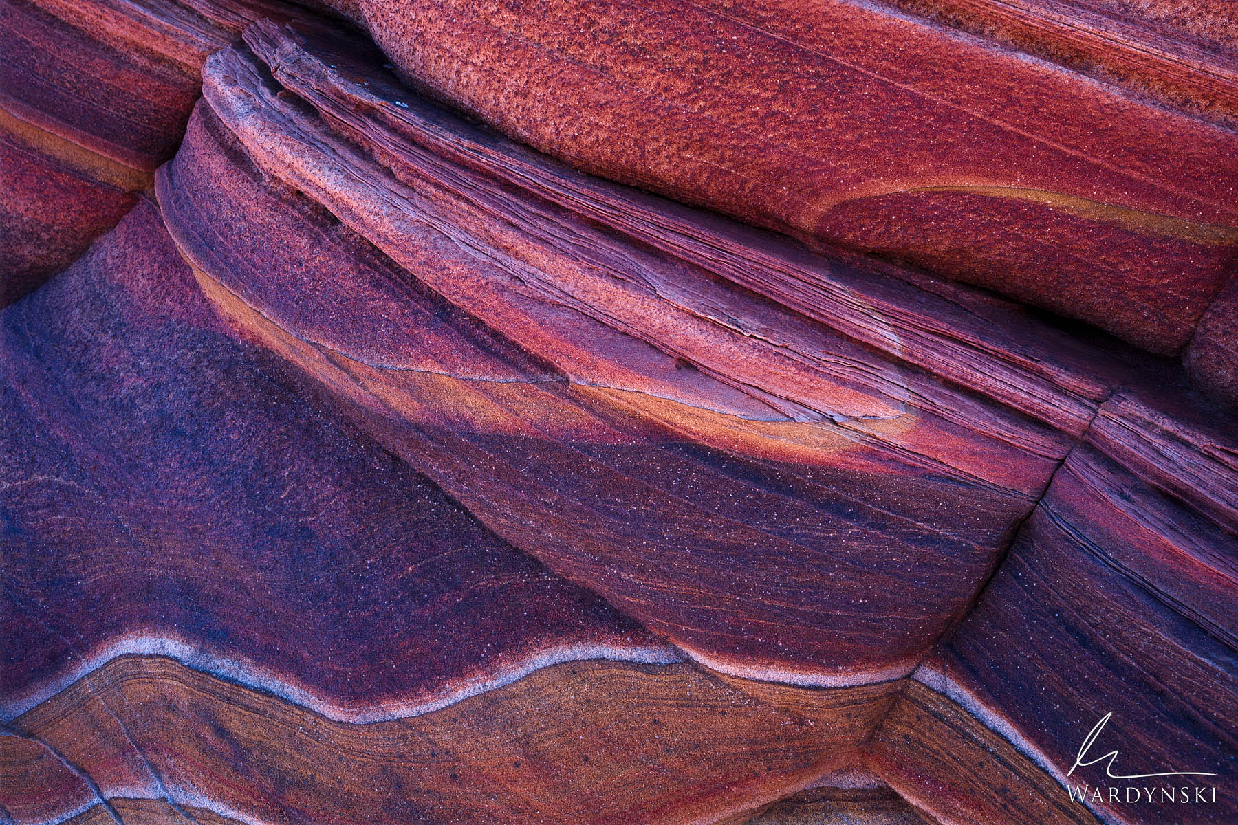 Fine Art Print | Limited Edition of 25  Purple and red striations swirl through multi colored sandstone like hard candy. The...