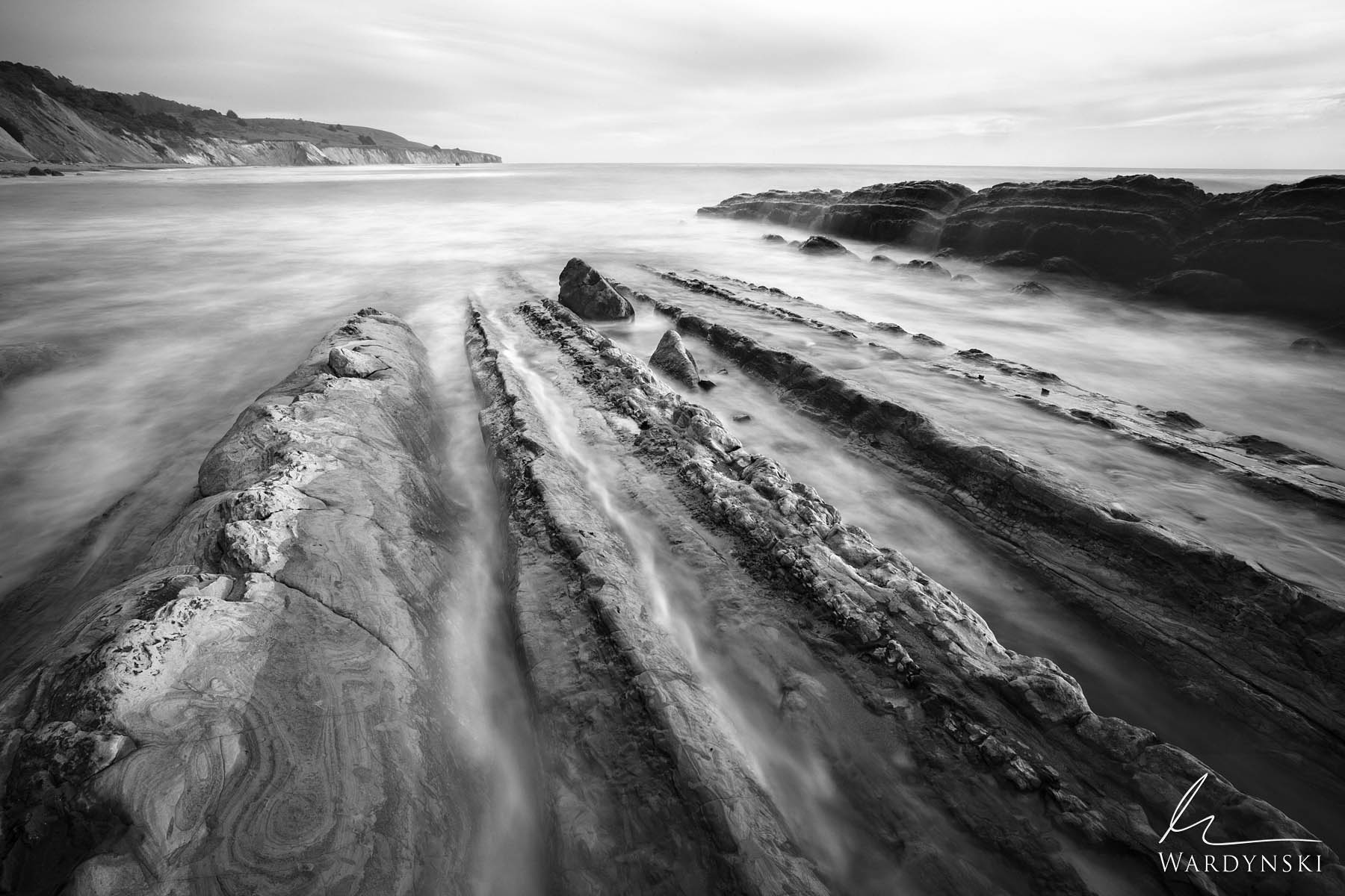 Black and White Fine Art Print | Limited Edition of 25  Sandstone fins lead into the chilly water of the Pacific Ocean near Point...