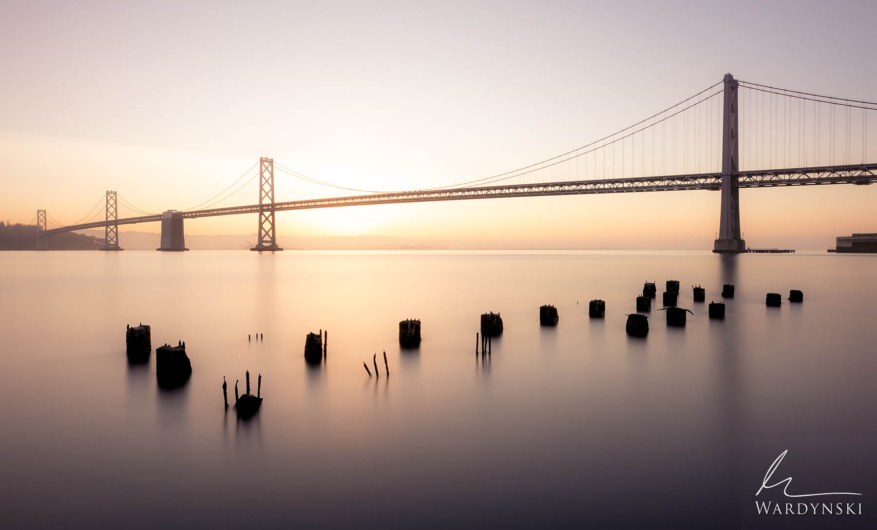 Fine Art Print | Limited Edition of 50  A warm glow emanates from behind the San Francisco span of the Bay Bridge at sunrise....