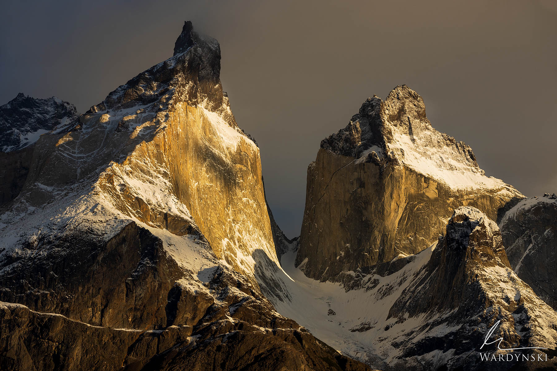Fine Art Print | Limited Edition of 100 |  Golden light strikes the face of Cuerno Principal and Cuerno Oriental in Torres Del...
