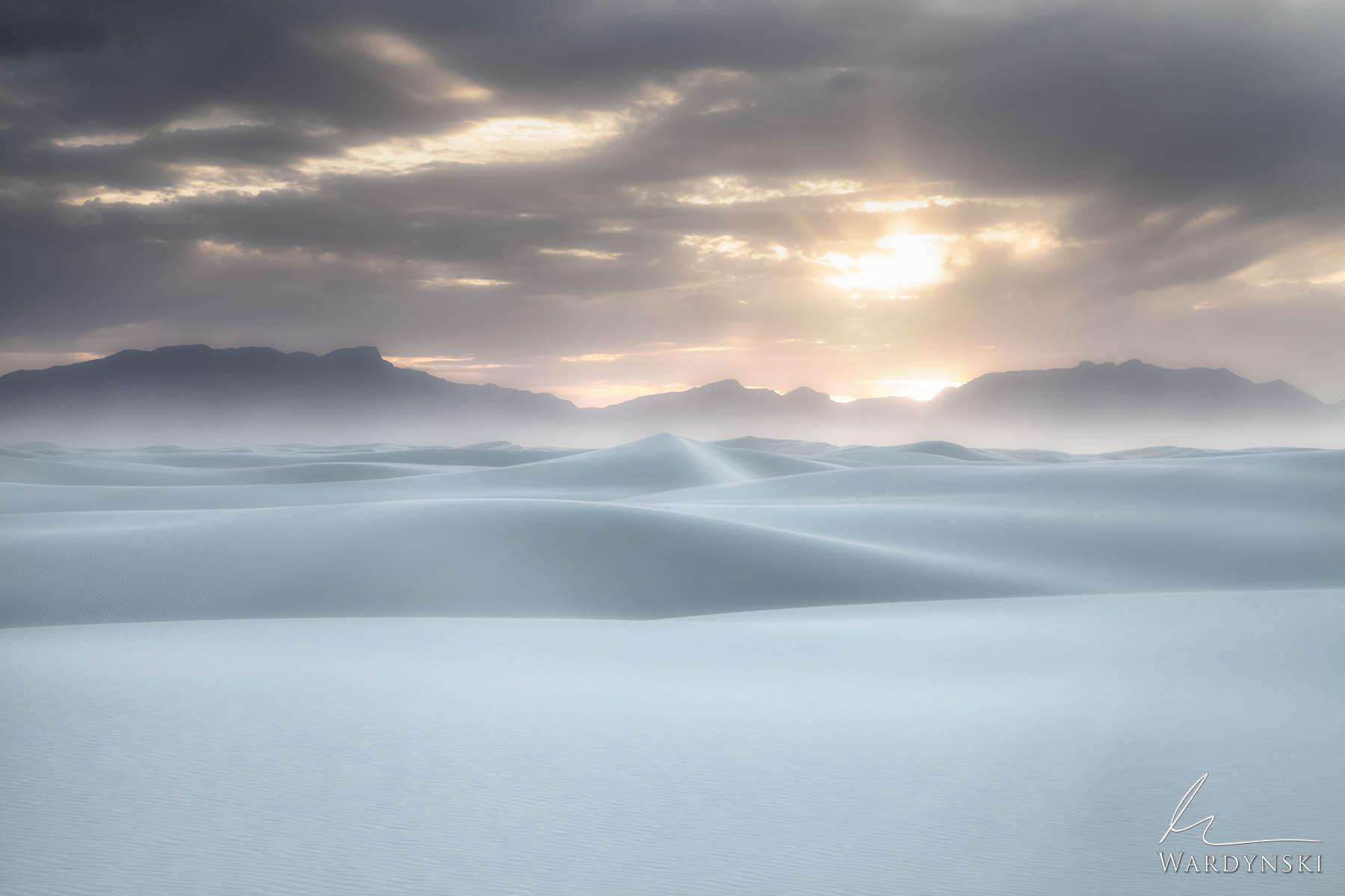 Fine Art Print | Limited Edition of 100 Sun rays burst through a cloudy sky during sunset in White Sands National Park, New Mexico...