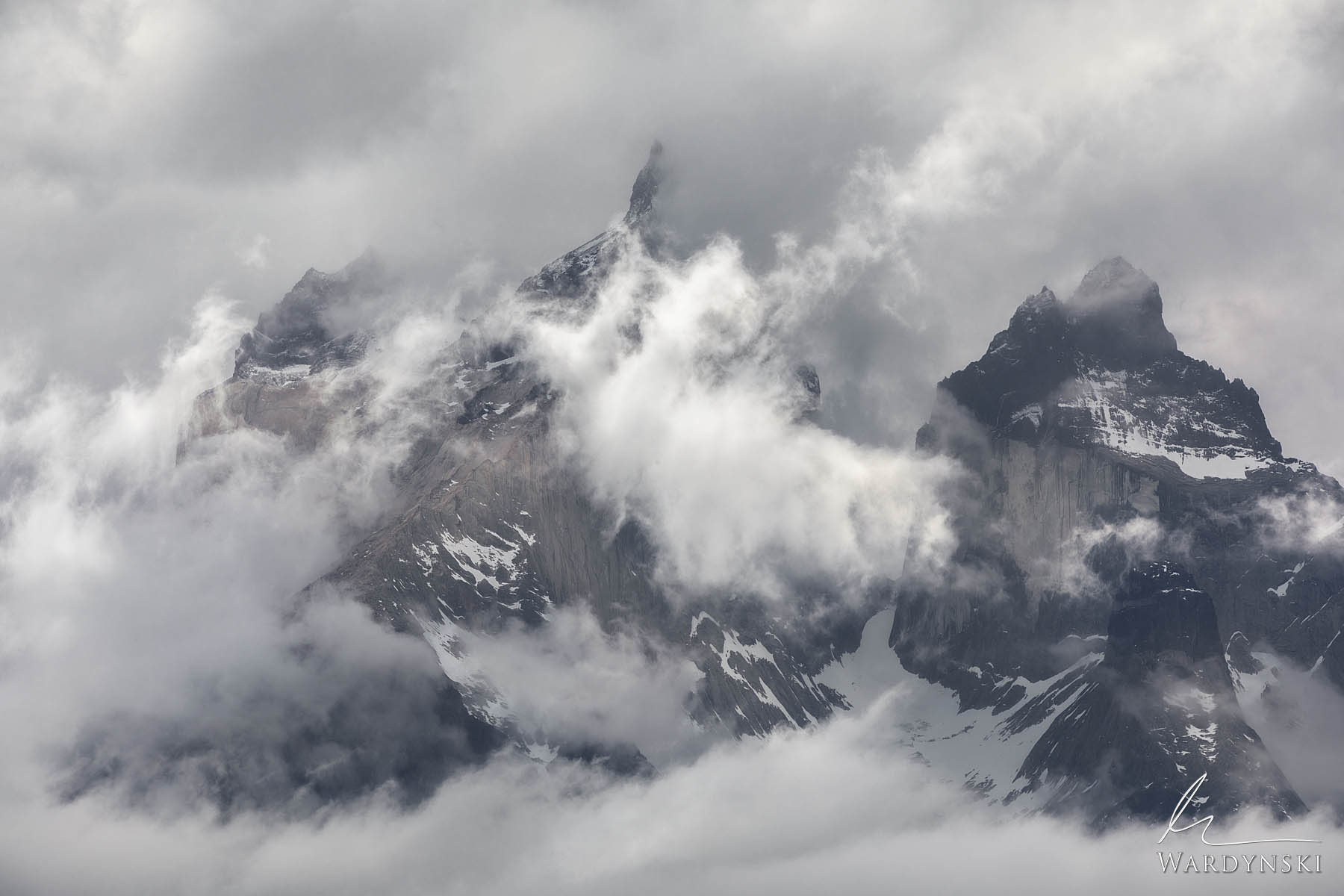 Fine Art Print | Limited Edition 50  Cuernos Del Paine towers out of an approaching late winter storm in Torres Del Paine, Patagonia...