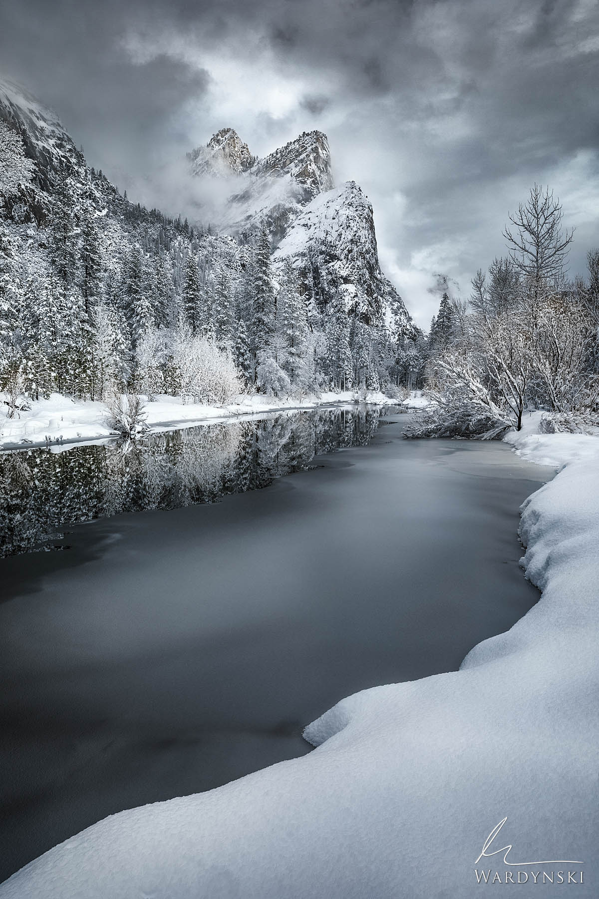 Fine Art Print | Limited Edition of 100  The Three Brothers tower over the Merced River in Yosemite National Park. The highest...