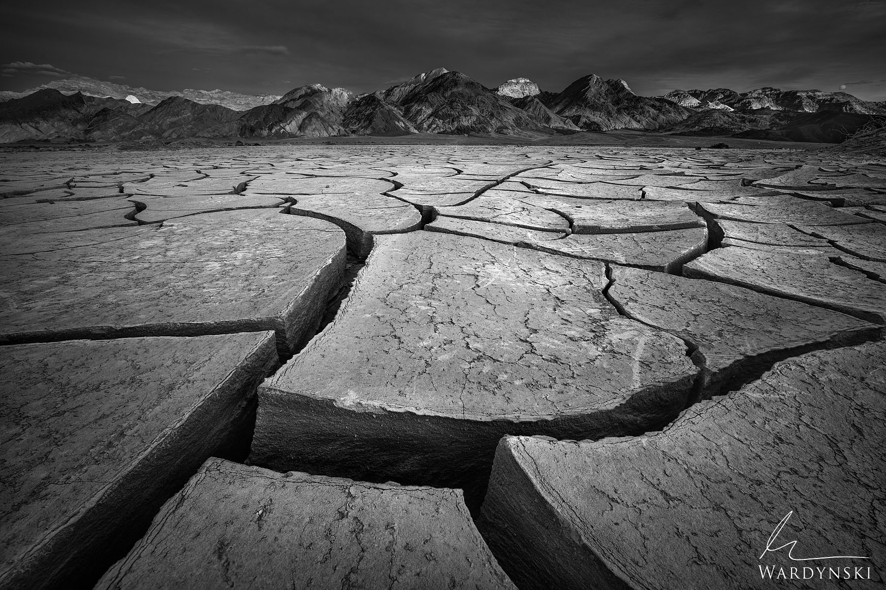 Black and White Fine Art Print | Limited Edition of 50  Deep mud cracks on the floor of Death Valley are formed by the harsh...
