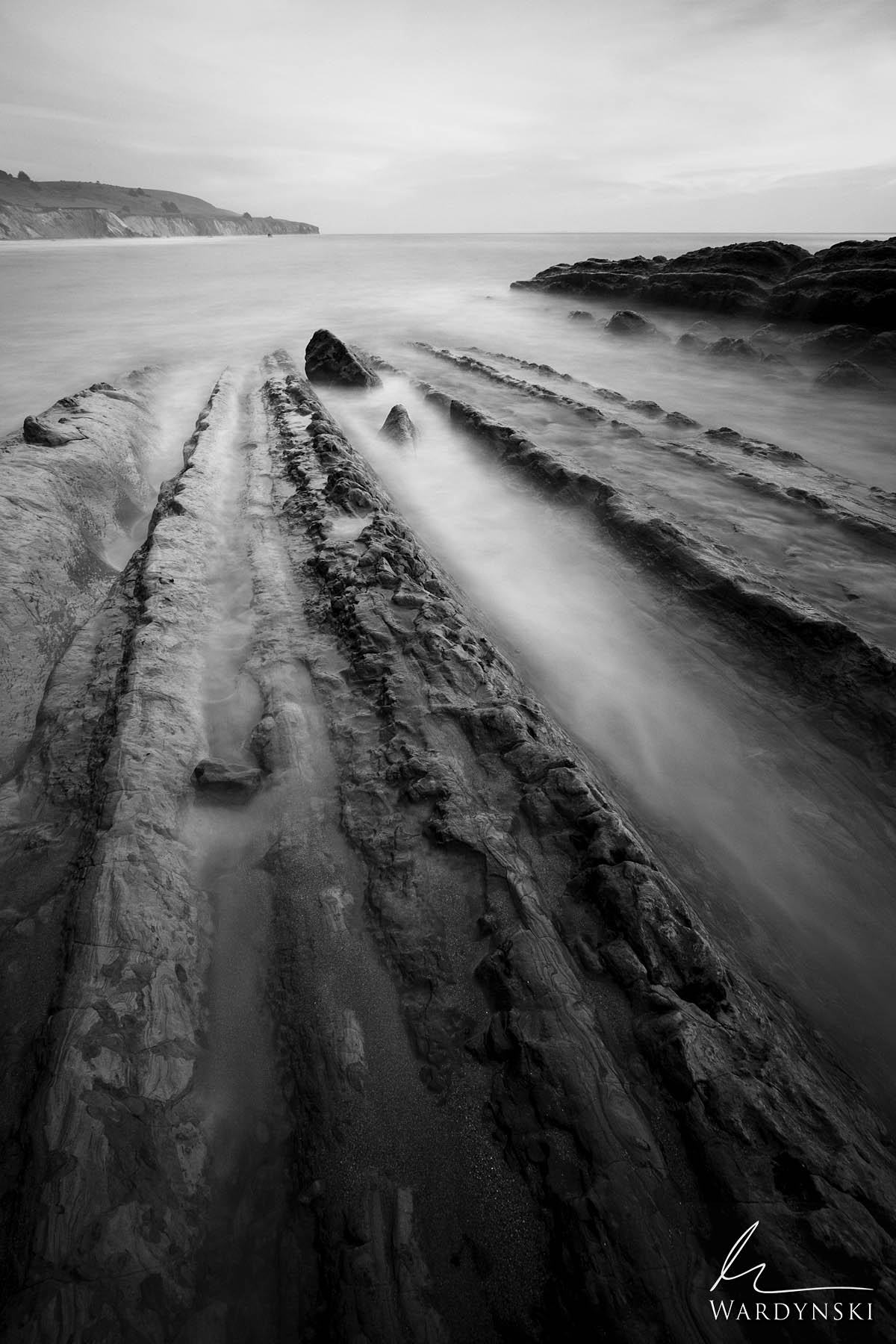 Black and White Fine Art Print | Limited Edition of 25  Veins of Sandstone lead into the Pacific Ocean in Northern California...