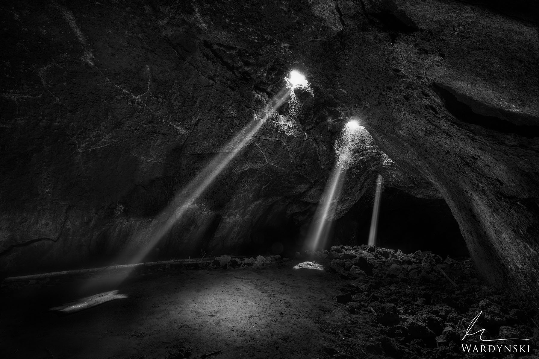 Black and White Fine Art Print   Limited Edition of 25  Beams of light shine into a small cave in Central Oregon. When the warm...