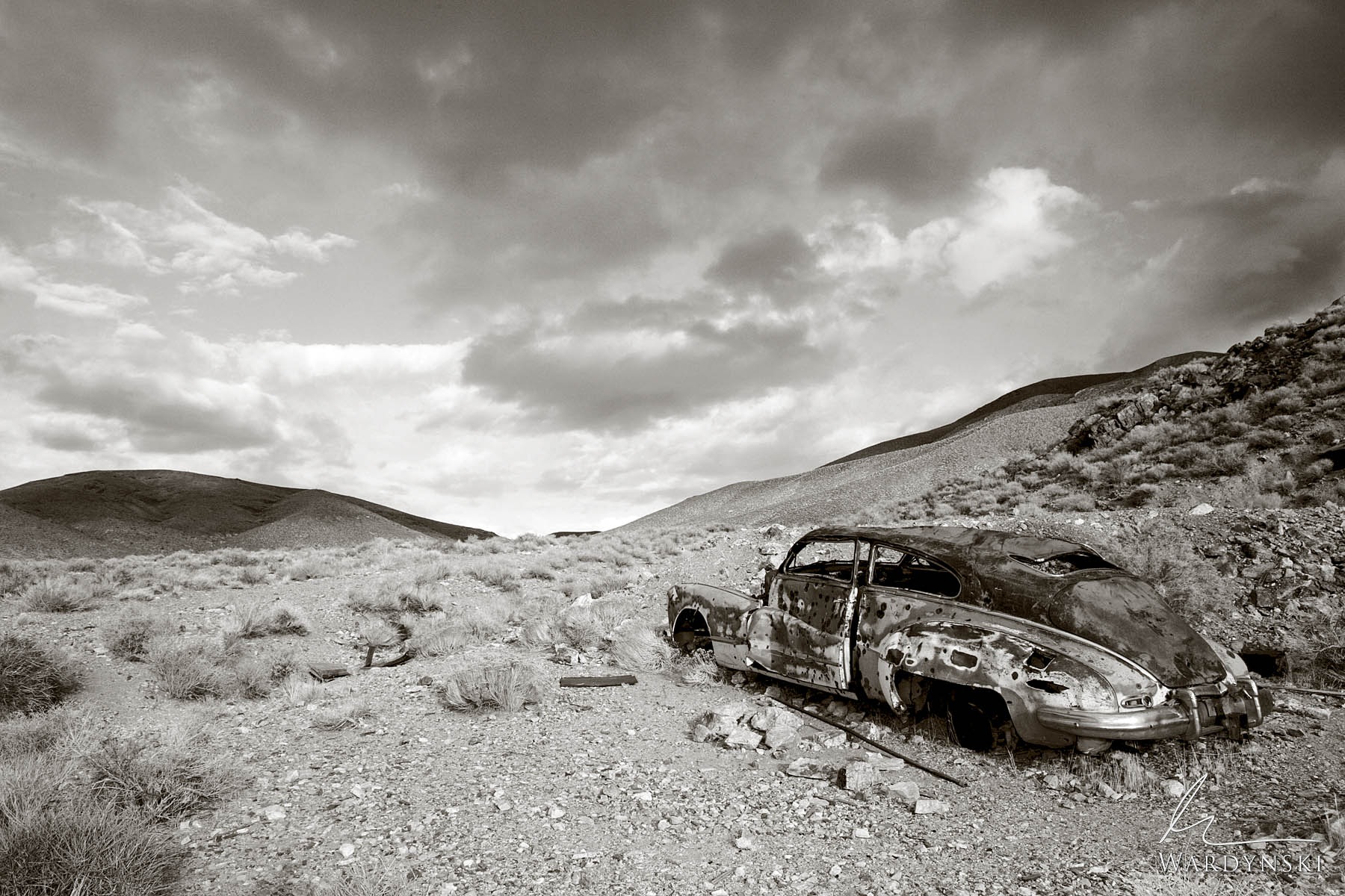Sepia Fine Art Print | Limited Edition of 20  A classic 1948 Buick Roadmaster lies rusting the the harsh desert of Death Valley...